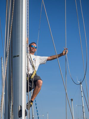 Rigger goes up and sort out the halyards.